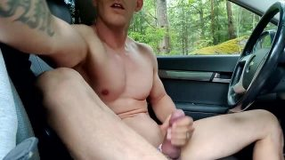 muscled men strokes his fat cock in his car